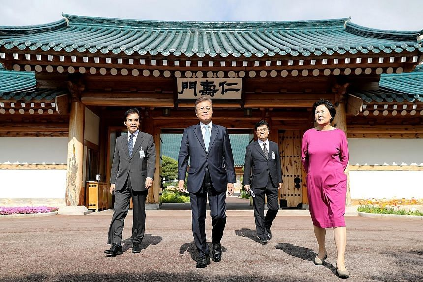 South Korean President Moon Jae In (centre) and his wife, Kim Jung Sook, outside the presidential Blue House in Seoul on May 15. Mr Moon will visit South-east Asia next month - his first to the region since he took office in May.