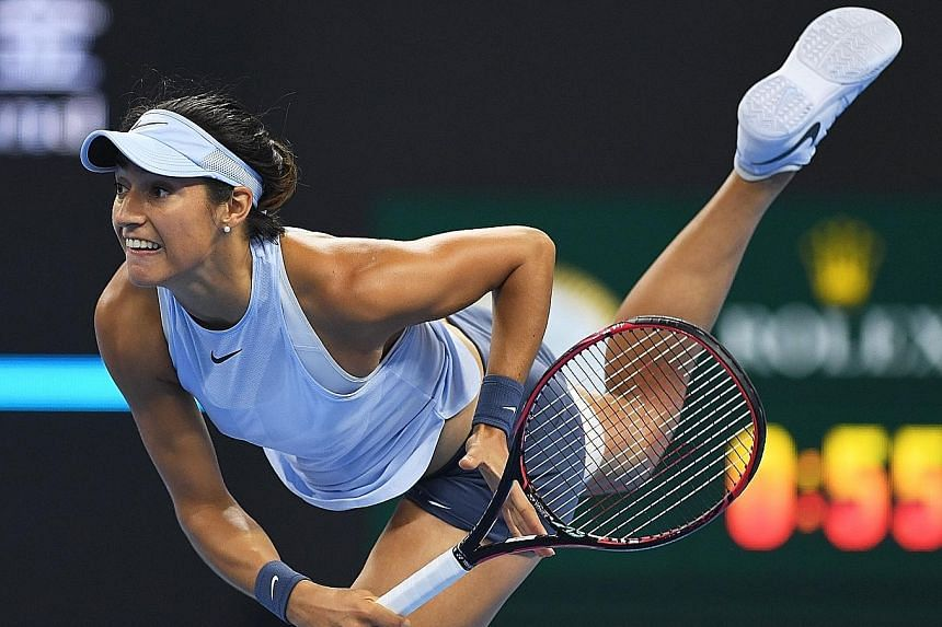 Caroline Garcia serving during the final of the China Open in Beijing against world No. 1 Simona Halep last Sunday. The Frenchwoman's back-to-back titles in Wuhan and Beijing put her into the WTA Finals for the first time.