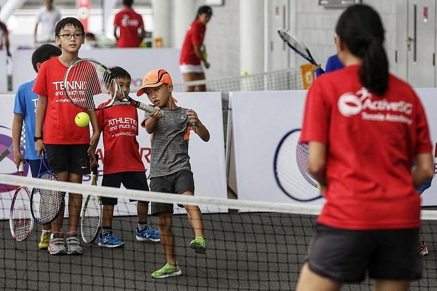 Eight-year-old Jerry Chea Ree making a forehand return during the Singapore Tennis Festival at the Sports Hub yesterday. These and other activities are part of the experience tours that SportSG will conduct during the week of the WTA Finals.