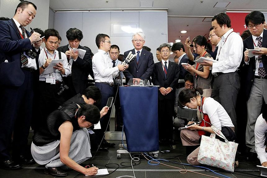 Kobe Steel CEO Hiroya Kawasaki speaking to the media in Tokyo yesterday. He said the company has found possible further cases of data tampering, including in overseas operations.