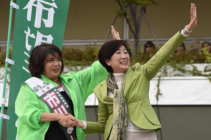 Tokyo Governor and leader of the Party of Hope Yuriko Koike (right) and party candidate Yoshiko Ichikawa at a rally yesterday.
