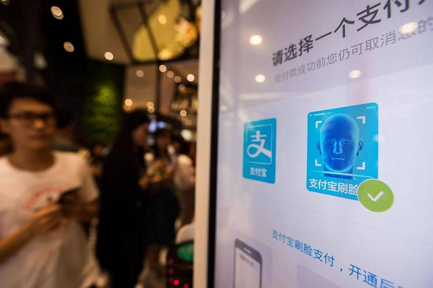 A payment icon is seen on the screen of the Smile to Pay system at a KFC fast food restaurant in Hangzhou, China.