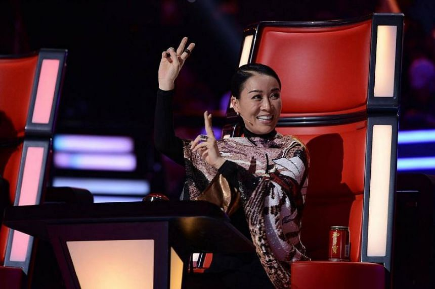 Eason Chan revealed that a director on the show had suggested he and another mentor, Na Ying (above), push the button and choose a contestant whom they would not have otherwise selected.