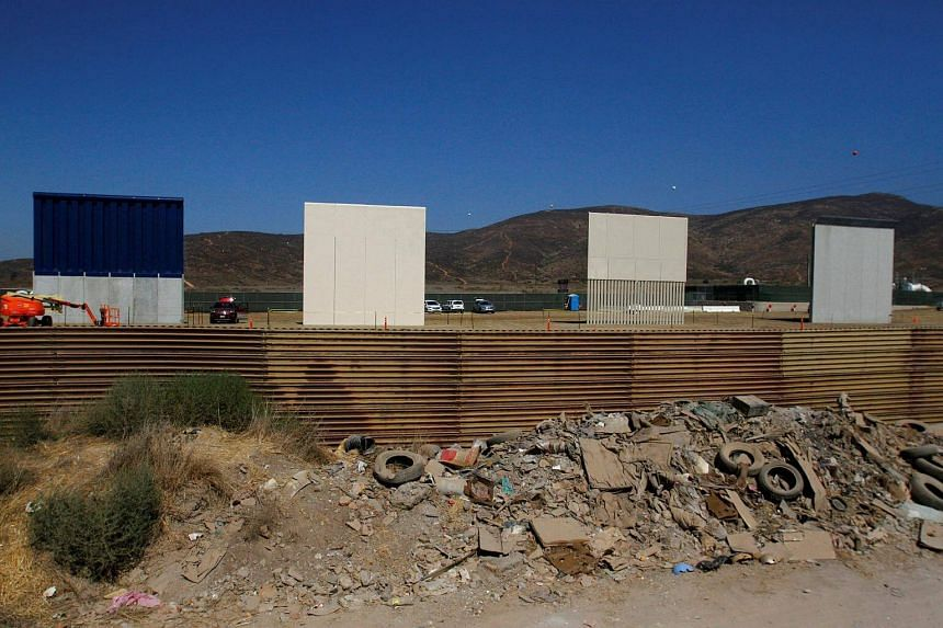 Prototypes for US President Donald Trump's border wall with Mexico are seen behind the current border fence.