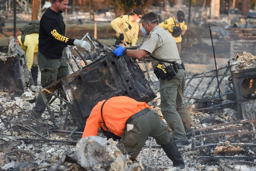 A search and rescue team searches for bodies at a property where a person was reported missing in Santa Rosa, California on Oct 12, 2017.