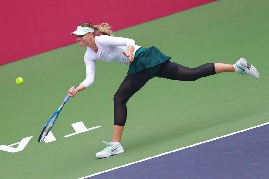 Maria Sharapova of Russia hits a return against Stefanie Voegele of Switzerland during their women's singles quarter-final match at the WTA Tianjin Open tennis tournament in Tianjin on Oct 13, 2017.