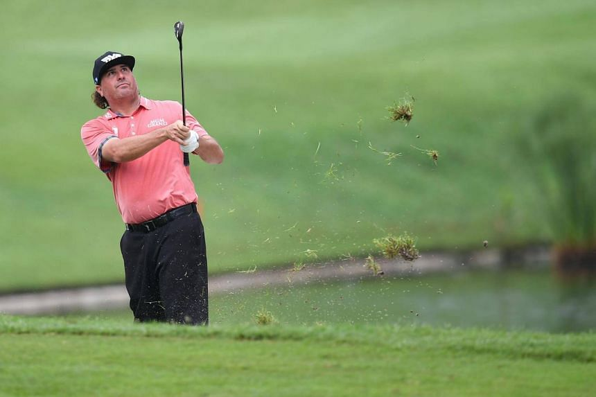 Pat Perez plays a fairway shot on the 15th hole during the second round of the 2017 CIMB Classic golf tournament in Kuala Lumpur on Oct 13, 2017.
