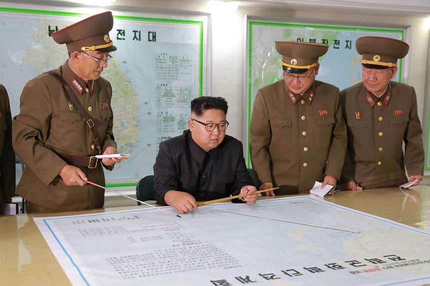 North Korean leader Kim Jong-Un (centre) inspecting the Command of the Strategic Force of the Korean People's Army (KPA) at an undisclosed location on Aug 14, 2017.