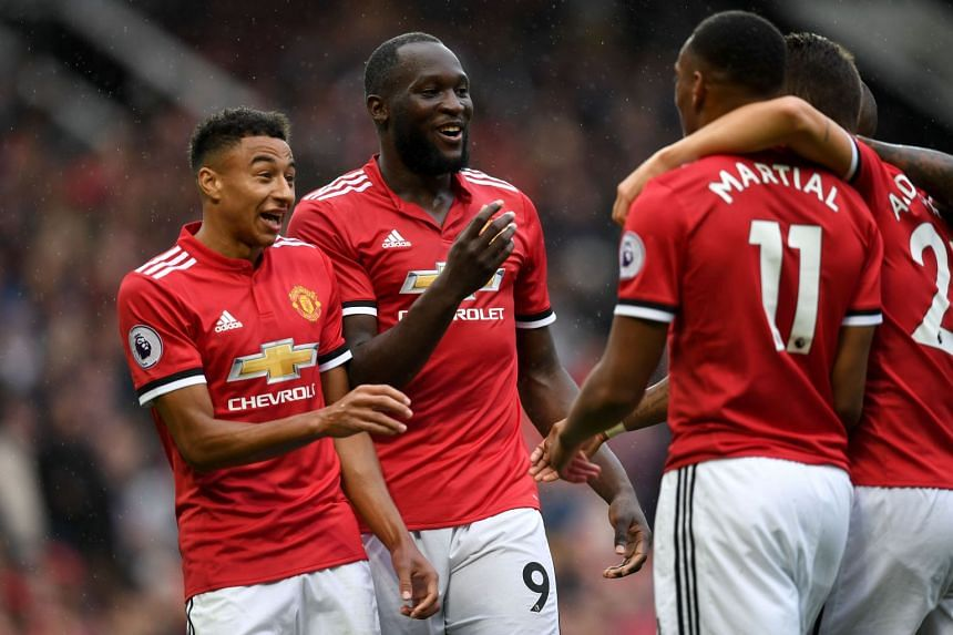 United's Belgian striker Romelu Lukaku (second left) celebrates a goal with team mates.
