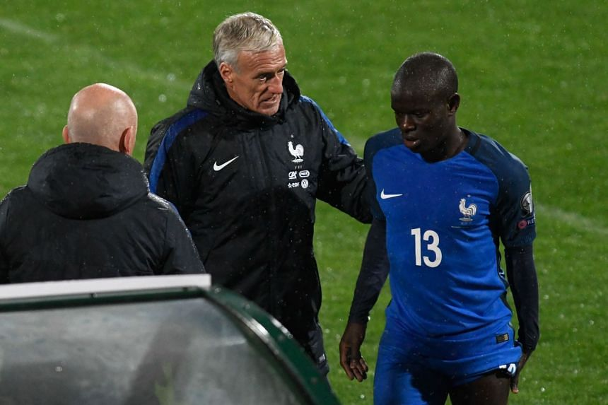Kante is comforted by France's coach Didier Deschamps after he was substituted during the World Cup match.