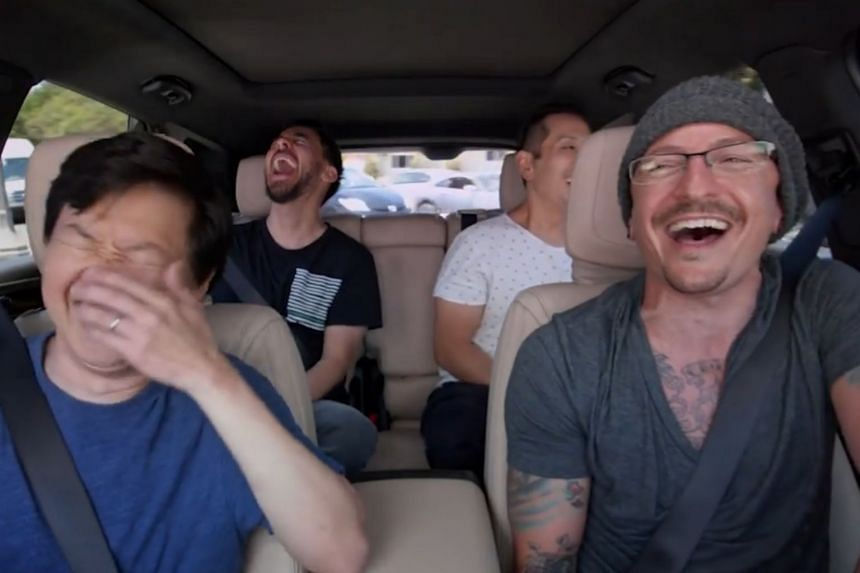 Linkin Park's Chester Bennington along with Mike Shinoda (back, left), Joe Hahn (back, right) and Ken Jeong singing along during an episode of Carpool Karaoke.