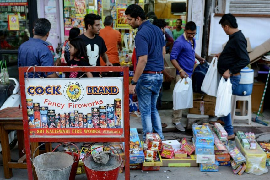 Indian people buying firecrackers at a shop in New Delhi on Oct 9, 2017.