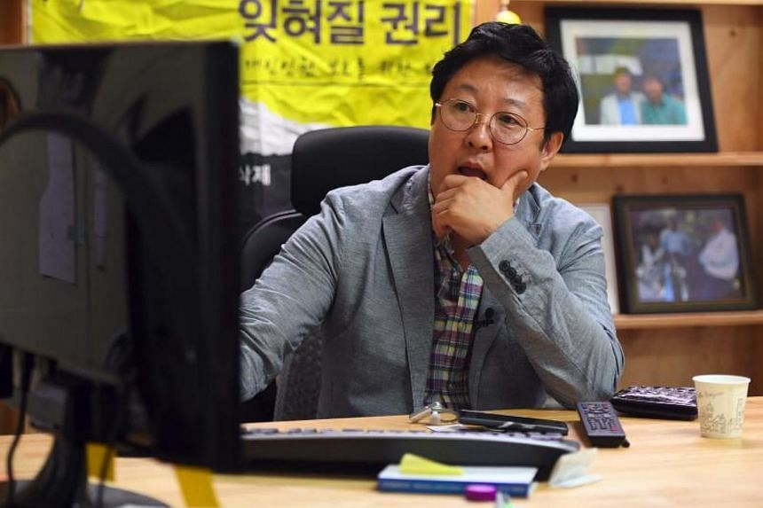 "CEO of Santa Cruise Kim Ho Jin checking a computer screen for ""revenge porn"" at his office in Seoul. The company is tasked with taking down videos posted without consent -- including so-called ""revenge porn."""
