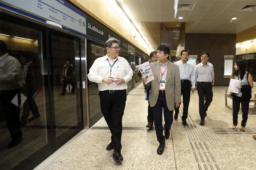Mr Masayoshi Isono, the international affairs special representative for Japan's Ministry of Land, Infrastructure, Transport and Tourism  (centre in light brown suit), visits the Bencoolen MRT Station on Oct 12, 2017.