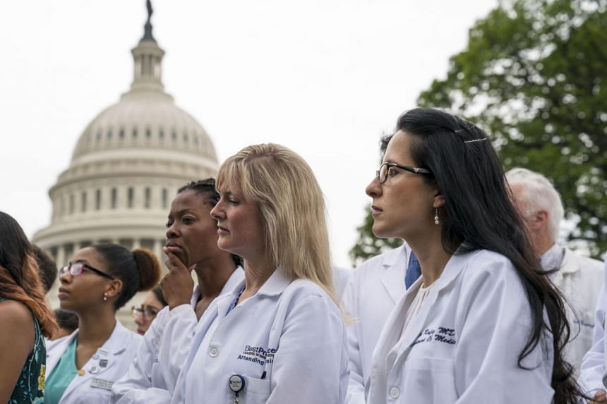 Health care workers participate in a demonstration outside the Capitol in Washington, on June 22, 2017.