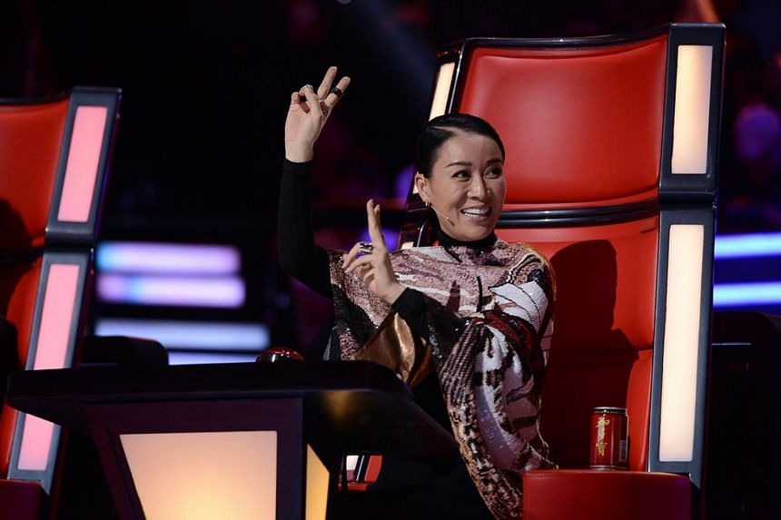 Television still: The Voice Of China Season 3, features Chinese singer Na Ying as a judge.