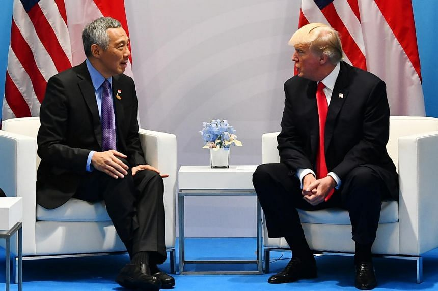Prime Minister Lee Hsien Loong meeting US President Donald Trump during the G20 Summit at Hamburg Messe on July 8, 2017.