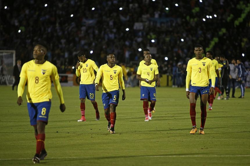 Ecuadorian players leave the field in dejection after losing to Argentina 3-1 during their 2018 World Cup football qualifier match in Quito