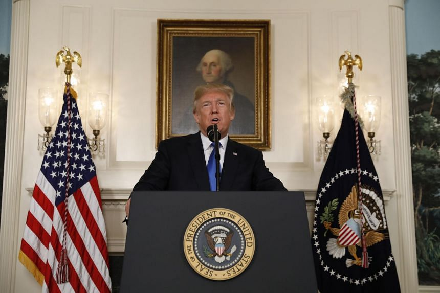 Trump speaks about the Iran nuclear deal in the Diplomatic Room of the White House.
