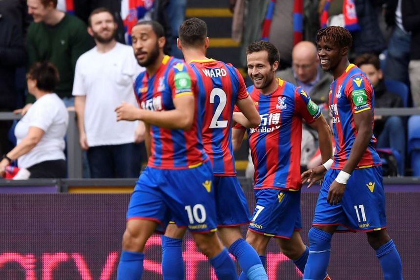 Crystal Palace's Yohan Cabaye celebrates scoring with Wilfried Zaha and team mates.