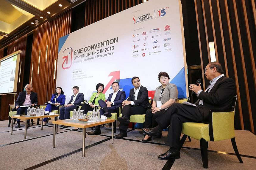 Senior Minister of State for Trade and Industry Sim Ann (fourth from left), at a panel discussion with SBF representatives, reassured SMEs that services would not be affected by the merger.