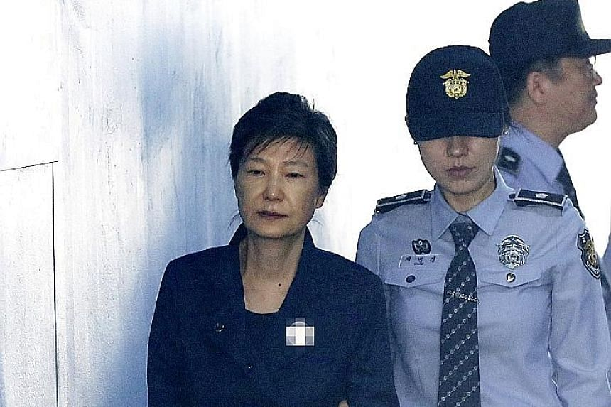 Ousted South Korean president Park Geun Hye, who has been detained while standing trial in a graft case, arriving at a court in Seoul yesterday.