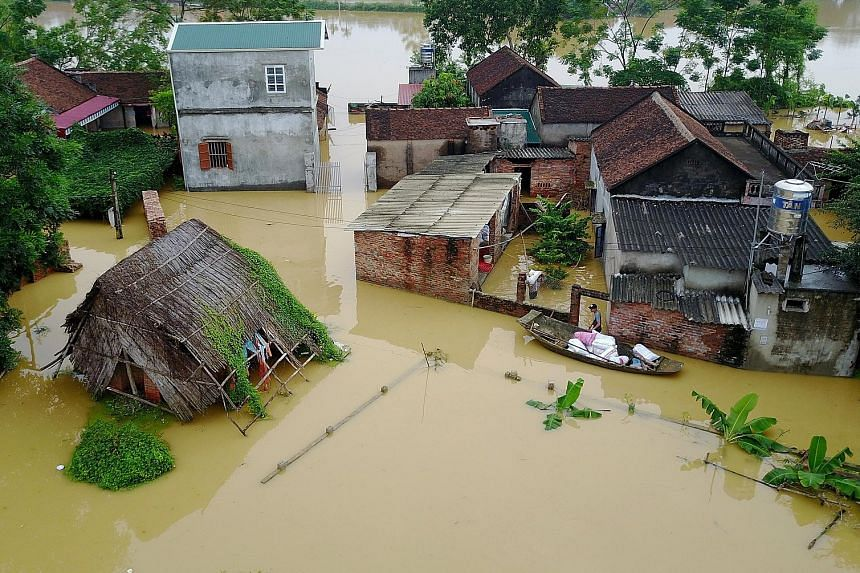 Houses in Hanoi affected by the floods. About 317 homes in the country have collapsed in floods and landslides this week, while more than 34,000 houses have been submerged or damaged.