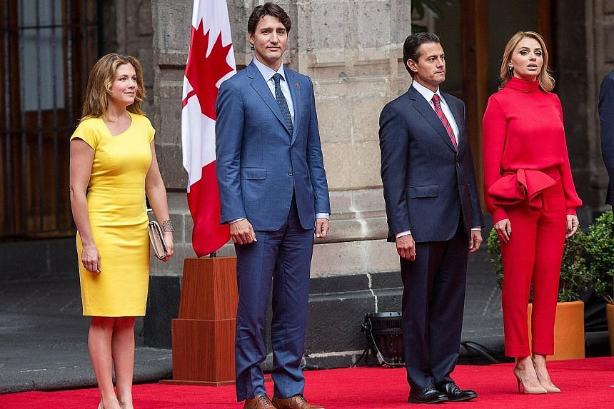 Canadian Prime Minister Justin Trudeau and his wife Sophie Gregoire Trudeau, with Mexican President Enrique Pena Nieto and his wife Angelica Rivera, at a welcoming ceremony at the Palacio Nacional in Mexico City.