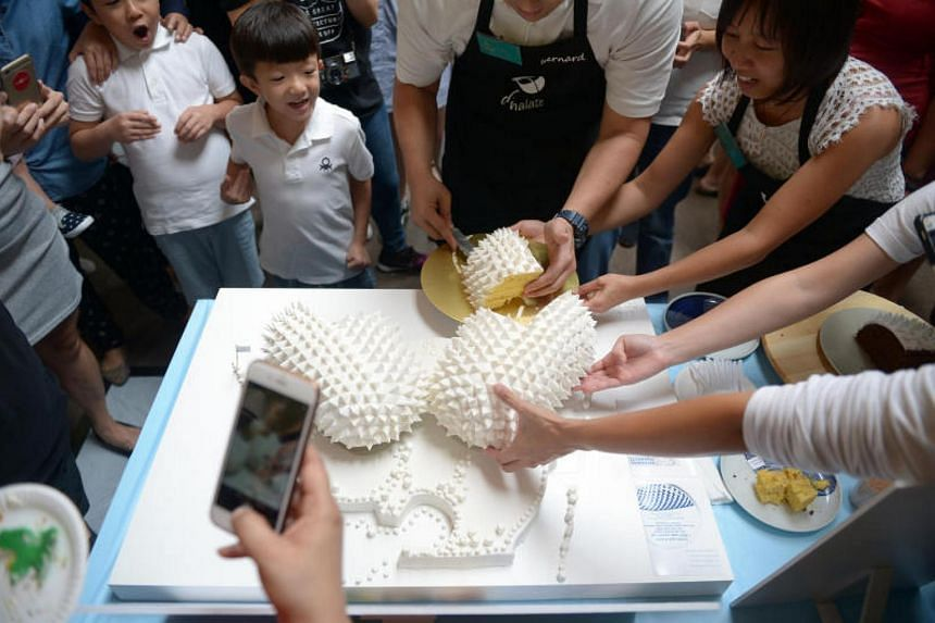 A team from local firm DP Architects created the winning Esplanade cake.