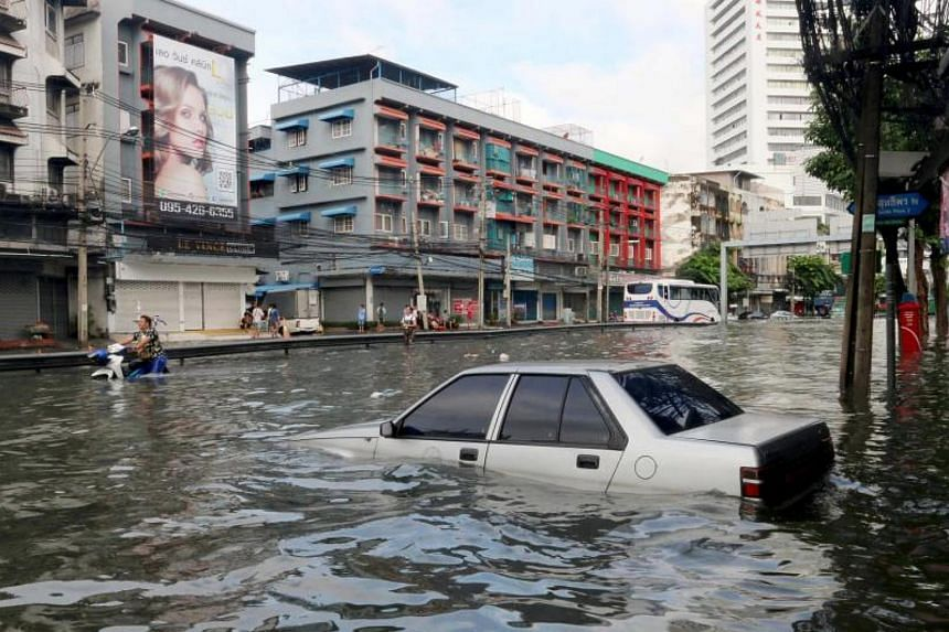 A car is submerged by floodwater at a street in central of Bangkok, Thailand, Oct 14, 2017.  The Bangkok Post reported that at least 55 major roads were submerged following heavy rain in the early hours of Saturday.