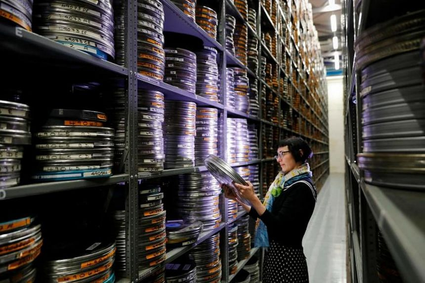 A chemical smell hangs in the air at the British Film Institute's National Archive, where some 250,000 wheels of old film are stacked floor-to-ceiling.