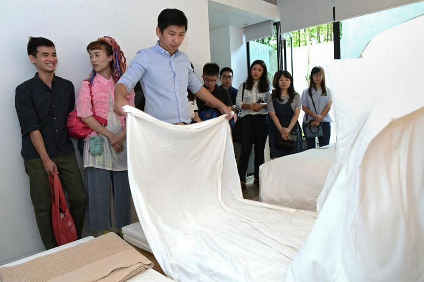 Housekeeping manager, Eric Tan, shows how a tatami bed is made.