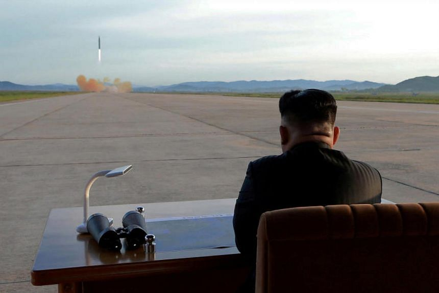 North Korean leader Kim Jong Un watches the launch of a Hwasong-12 missile in this undated photo released on Sept 16, 2017.
