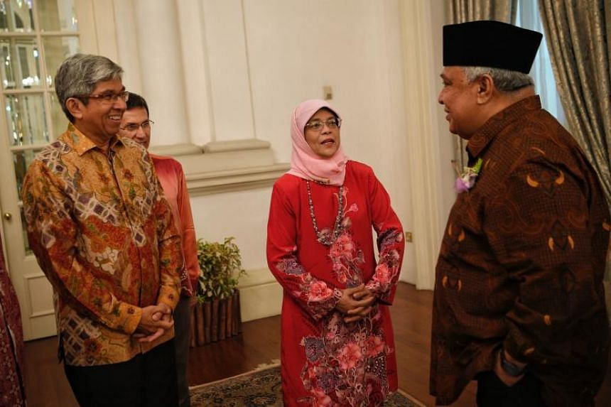 From left, Minister in Charge of Muslim Affairs Dr Yaacob Ibrahim, MUIS president Hj Mohd Alami Musa, and President Halimah Yacob, speak to MUIS award receipient Ustaz Hj Ali Bin Mohamed before the awards ceremony.