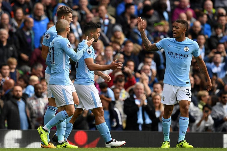Manchester City's Brazilian striker Gabriel Jesus (right) gestures to Manchester City's Argentinian striker Sergio Aguero after Aguero scores the opening goal of the English Premier League football match between Manchester City and Liverpool at the E