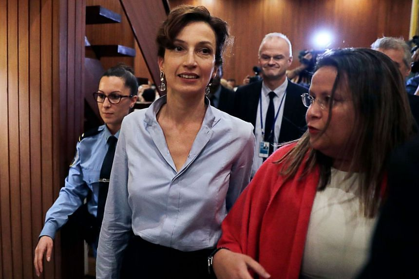Azoulay (centre) arrives to give a press conference following her election.