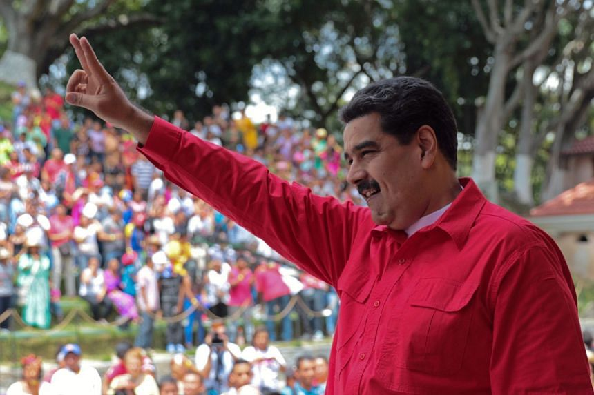 This handout picture released by the Venezuelan Presidency shows President Nicolas Maduro greeting supporters during a meeting at Miraflores presidential palace in Caracas on Oct 12, 2017.