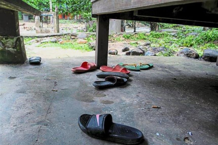 What remains: Footwear of the children left near the scene of the tragedy at Lubuk Semilang in Kuah.