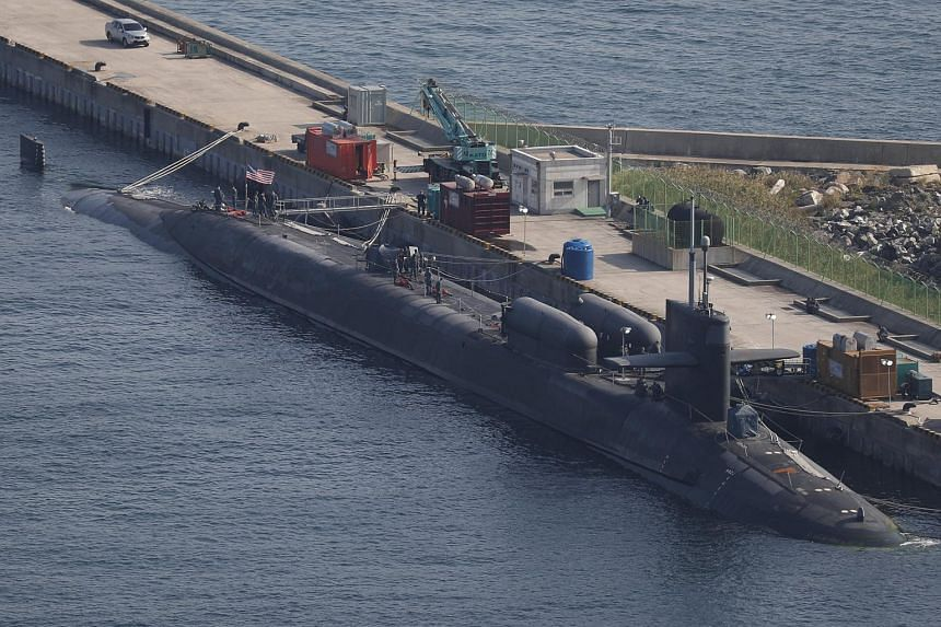 The USS Michigan (SSGN 727), the second Ohio-class nuclear-powered guided missile submarine in the US Navy, is docked at naval base in Busan, South Korea, on Oct 13, 2017.