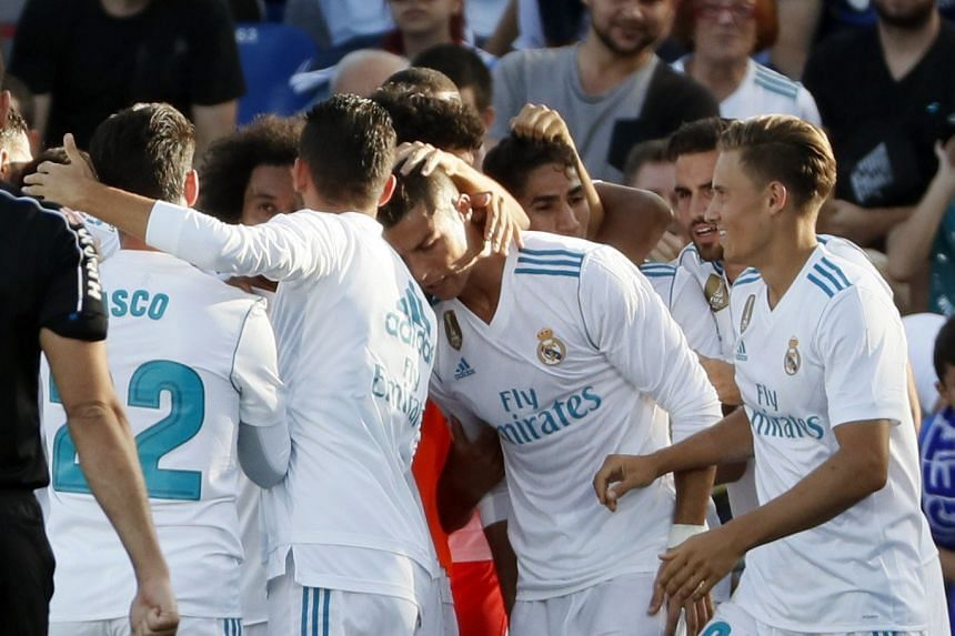 Ronaldo (centre) celebrates a goal with team mates.