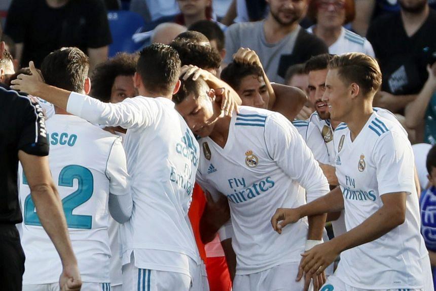 Ronaldo (centre) celebrates a goal with team mates.