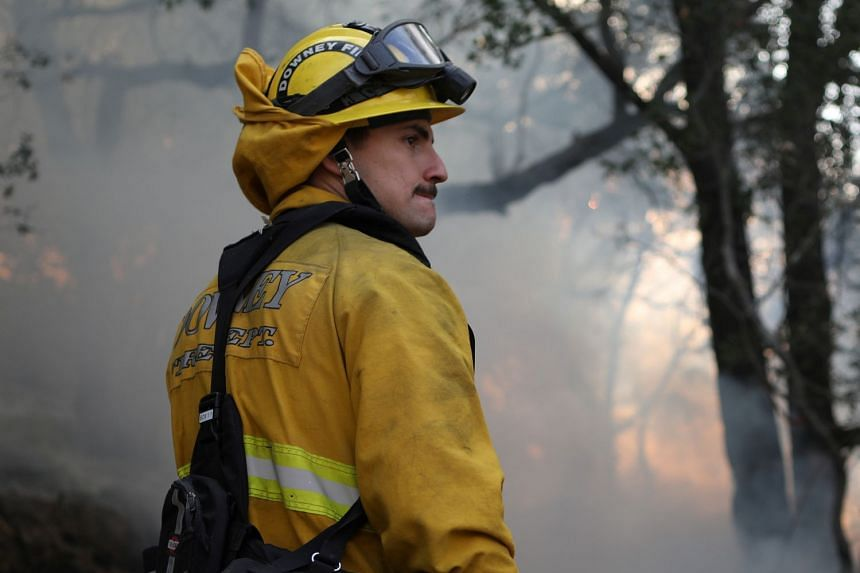 Firefighters work to control a wildfire in Sonoma, California, Oct 14, 2017.