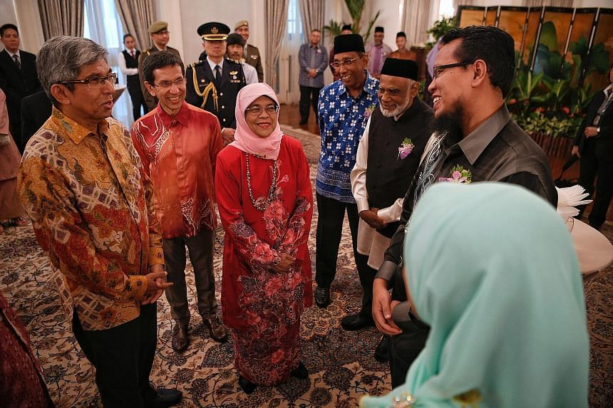 (from left) Minister-in-charge of Muslim Affairs Yaacob Ibrahim, Muis president Mohammad Alami Musa, President Halimah Yacob and award recipients Yusoff Mohamed, Hasan Kutus Meerasahib, Abdul Jabar Mustaffa and Juriah Yatim (with back to camera) at t