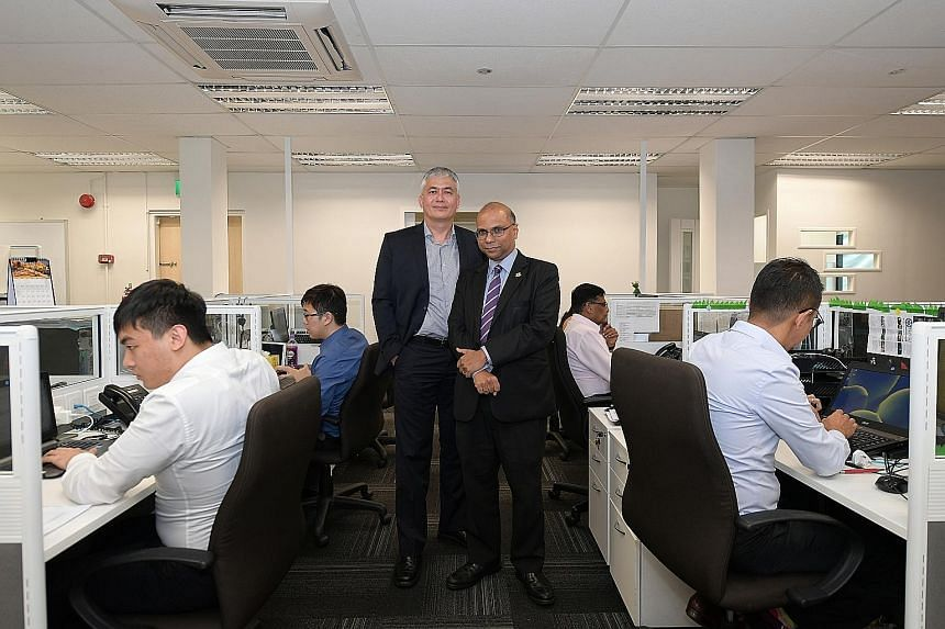 Law Society Pro Bono Services chief executive officer Lim Tanguy (left) and chairman Gregory Vijayendran in the new LSPBS office.