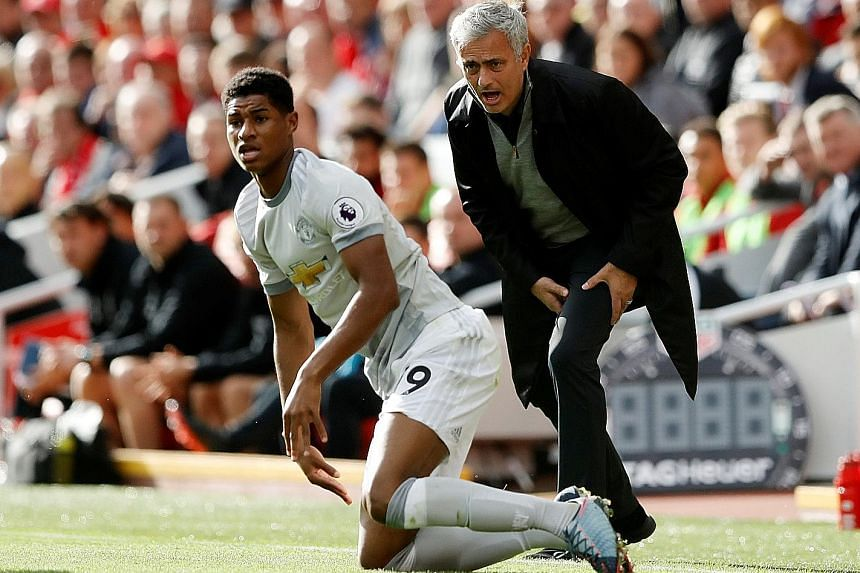 Jose Mourinho shows the strain as Marcus Rashford takes a tumble during the 0-0 draw. The Manchester United manager admitted that Liverpool's midfield had dictated terms and he had not been able to counter their strength.