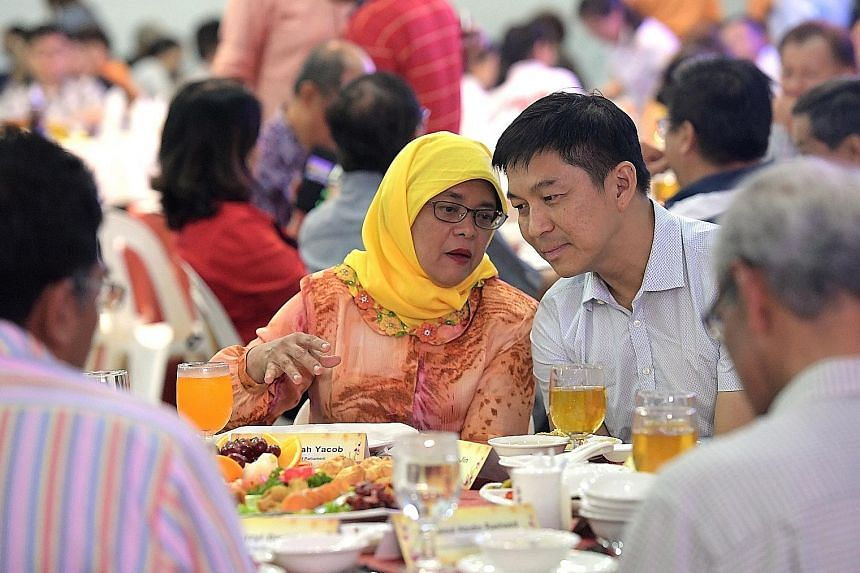 President Halimah Yacob with Mr Tan at a Seventh Month auction dinner last month. He took up the post of Speaker of Parliament, which was vacated by Madam Halimah, who resigned to contest the presidential election.