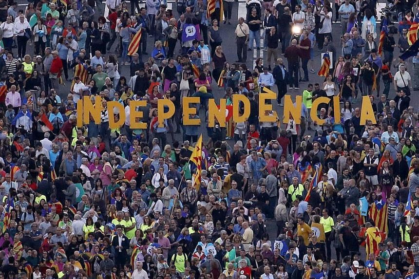 Protesters gathering during a demonstration in support of the Catalan independence referendum in Barcelona on Sept 29, 2017.