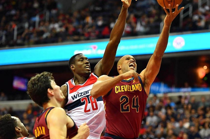 Cleveland Cavaliers forward Richard Jefferson attempts a shot as Washington Wizards center Ian Mahinmi defends during the first half at Capital One Arena.