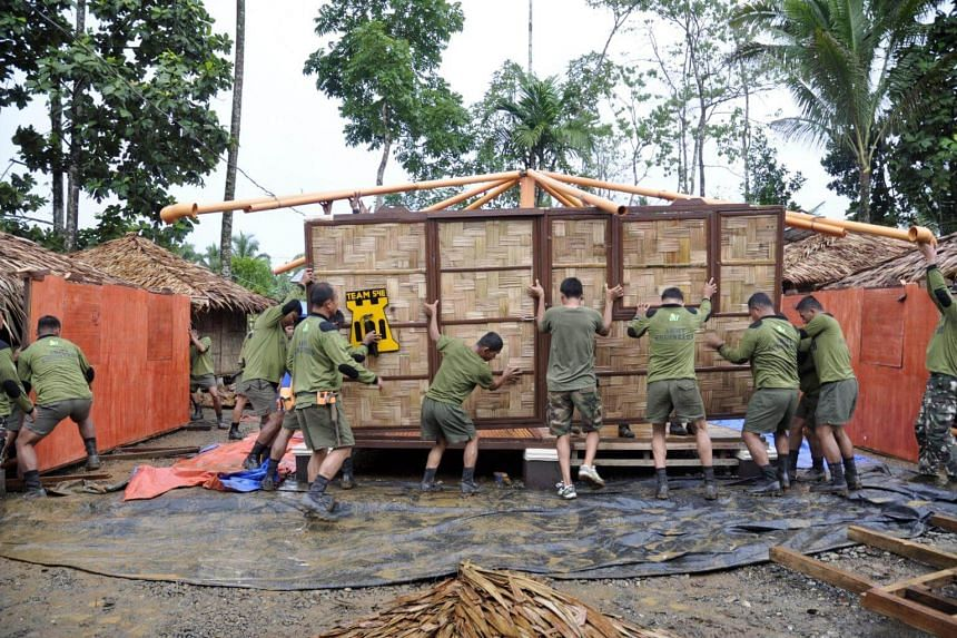Filipino soldiers building houses for internally displaced families in the war torn city of Marawi, Philippines, on Oct 2, 2017.