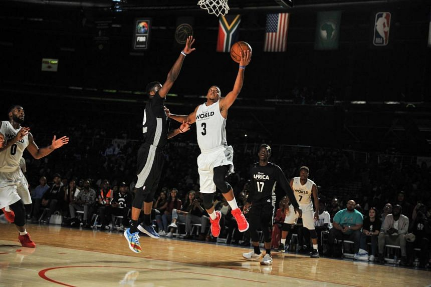 NBA player CJ McCollum (right) from the Portland Trailblazers vies during the NBA Africa Game 2017 basketball match between Team Africa and Team World in Johannesburg on Aug 5, 2017.